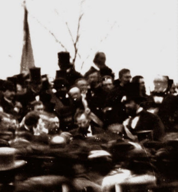 Hatless, centre, Lincoln delivers the Gettysburg  Address
