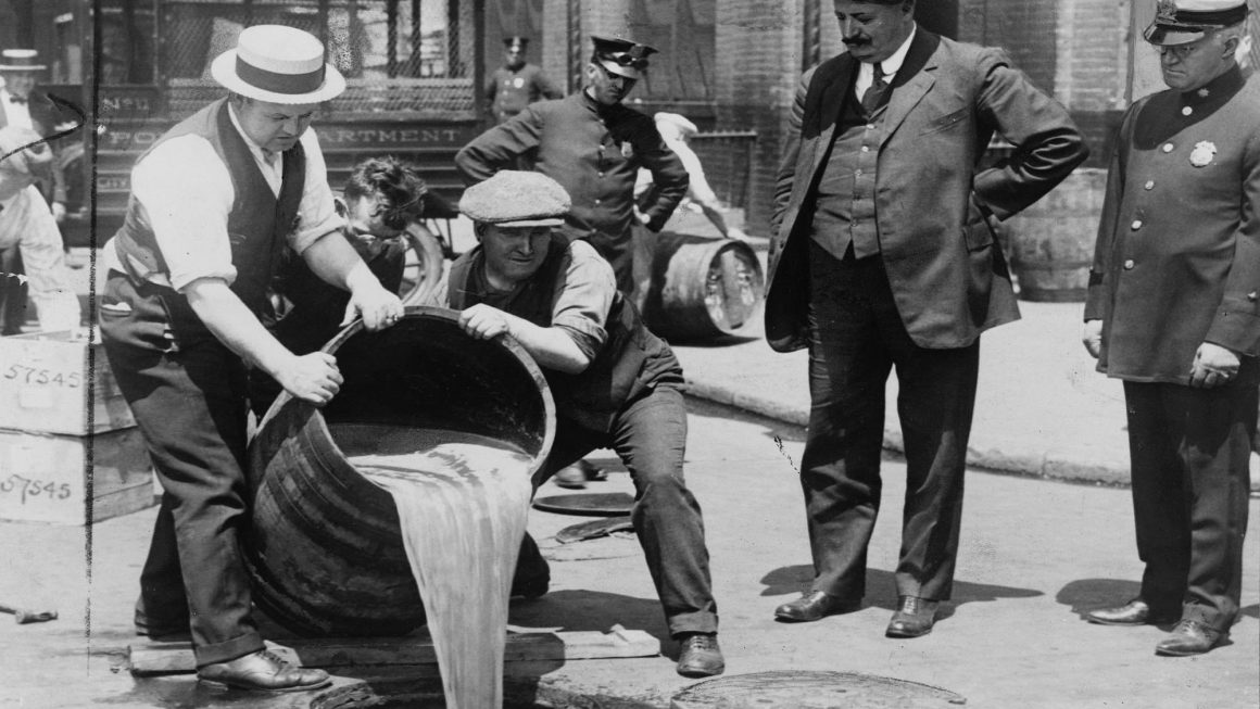 Beer is poured down the drains as Prohibition takes a hold in the United States