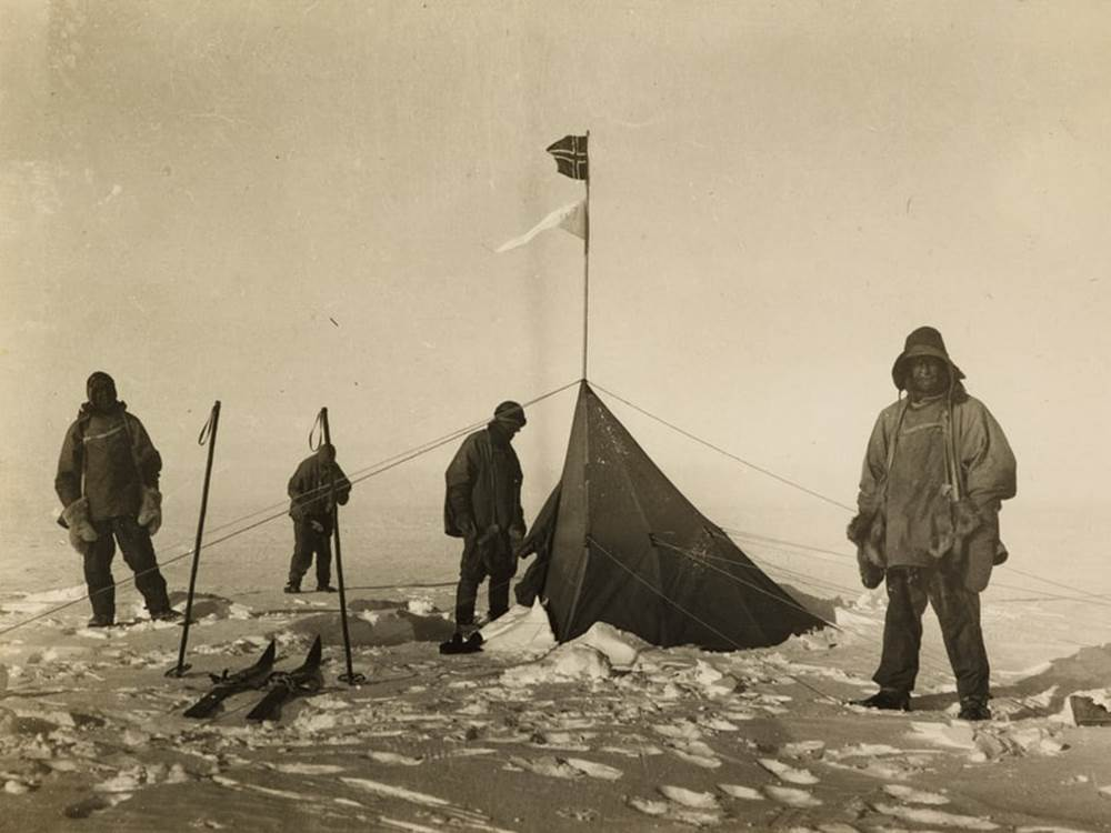 The British party, l-r Scott, Oates, Wilson and Evans reach Amundsen's tent. Photo: Henry Bowers/British Library