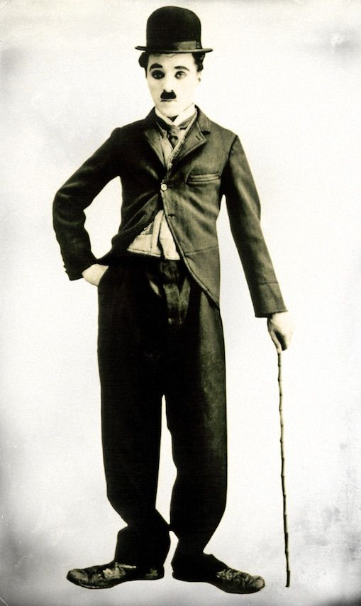 Charlie Chaplin in the lovable tramp role that made him famous