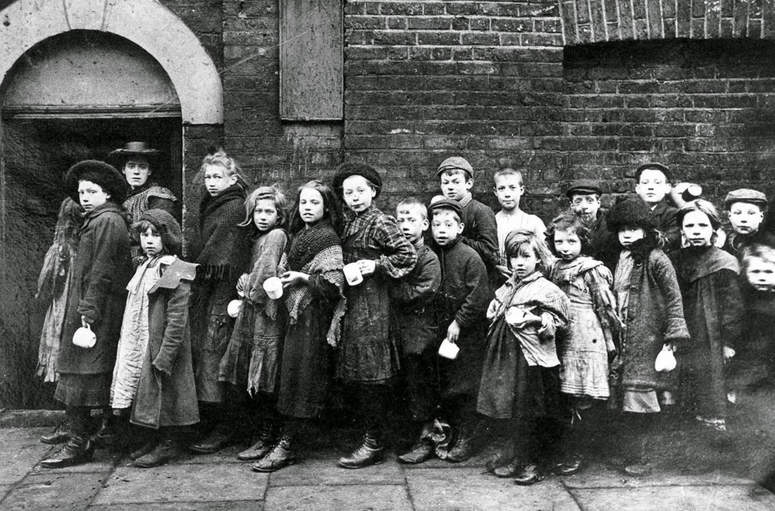 Children lining up for work outside a factory in the late nineteenth century