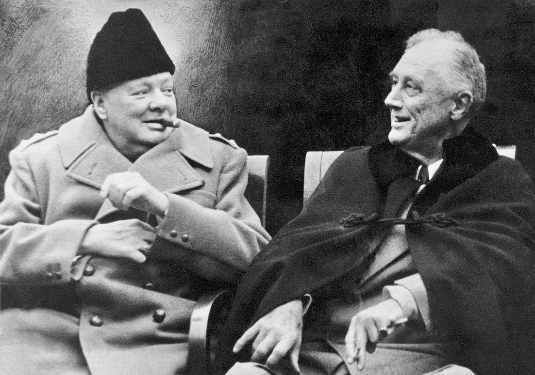 """Do you like my hat?"" Prime Minister Winston Churchill and President Franklin Roosevelt share a light moment"