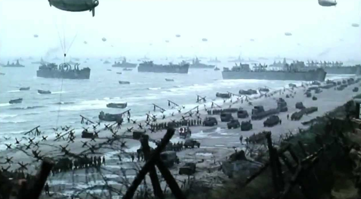 With the first barricades broken, troops assemble their equipment, including vehicles, on Omaha Beach