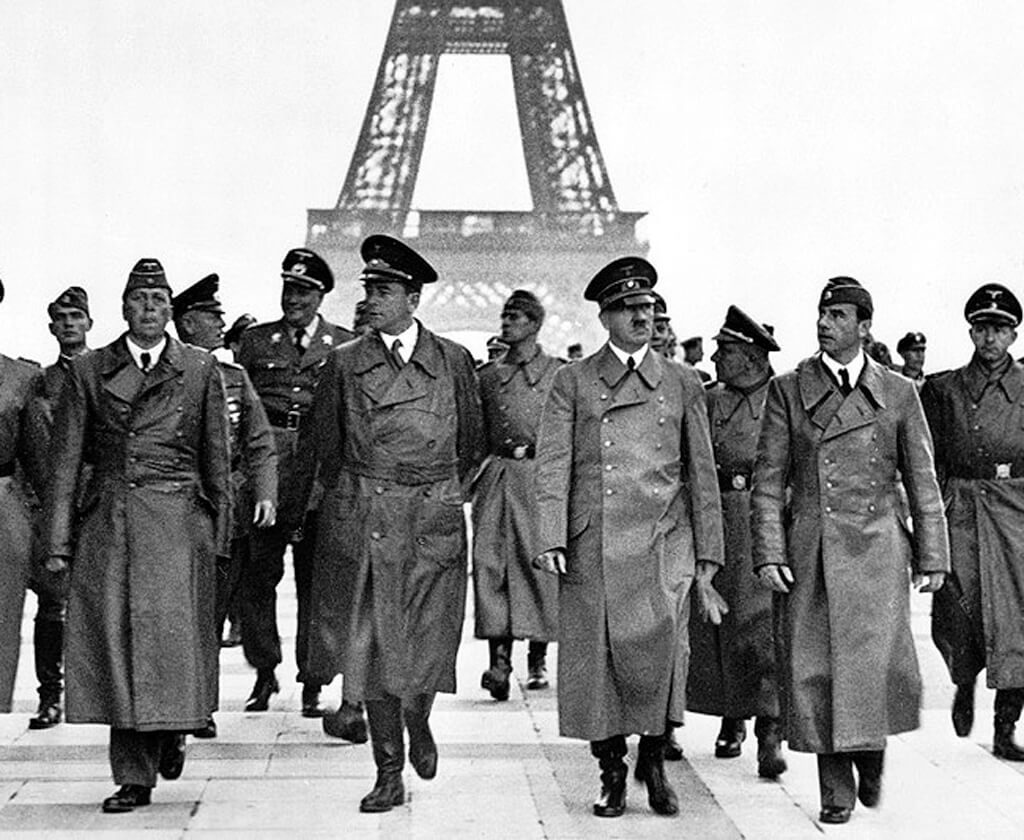 Hitler and his entourage strutting in front of the Eiffel Tower