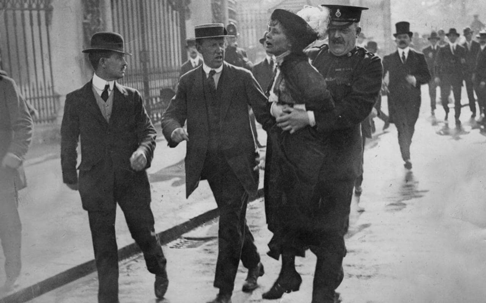 Another day, another arrest: Emmeline Pankhurst is manhandled away from Buckingham Palace by a burly police officer