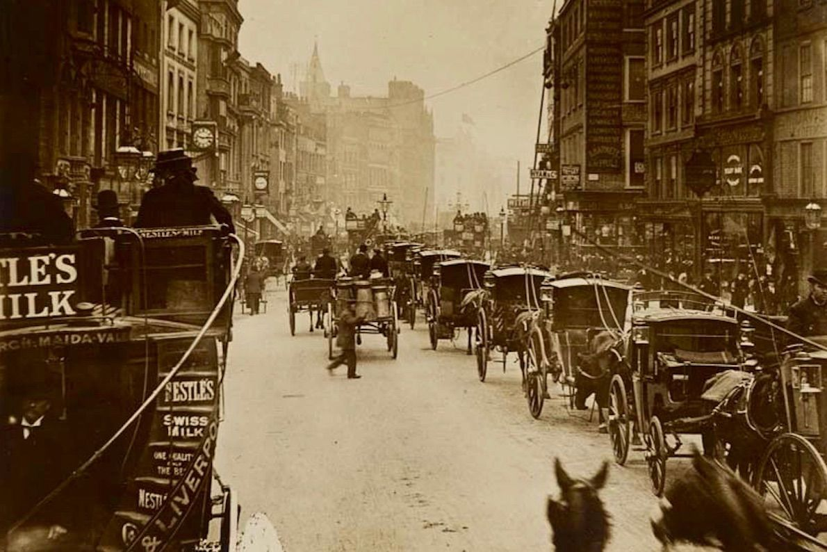 Hansom cabs wait for business in a London street