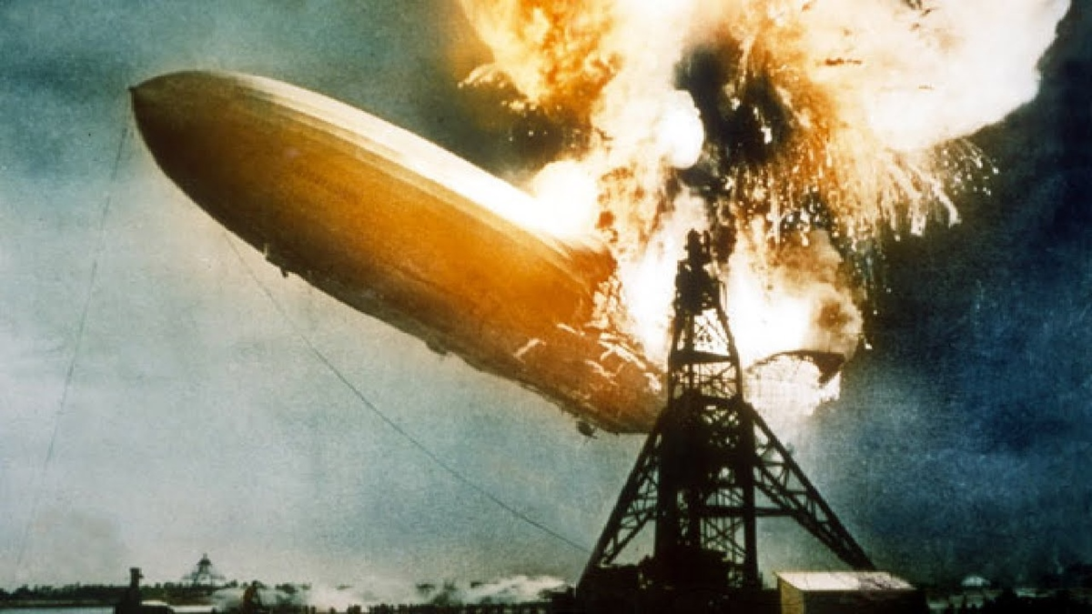 The Hindenburg bursts into flames as it approaches its mooring mast. Thirty-six people died.