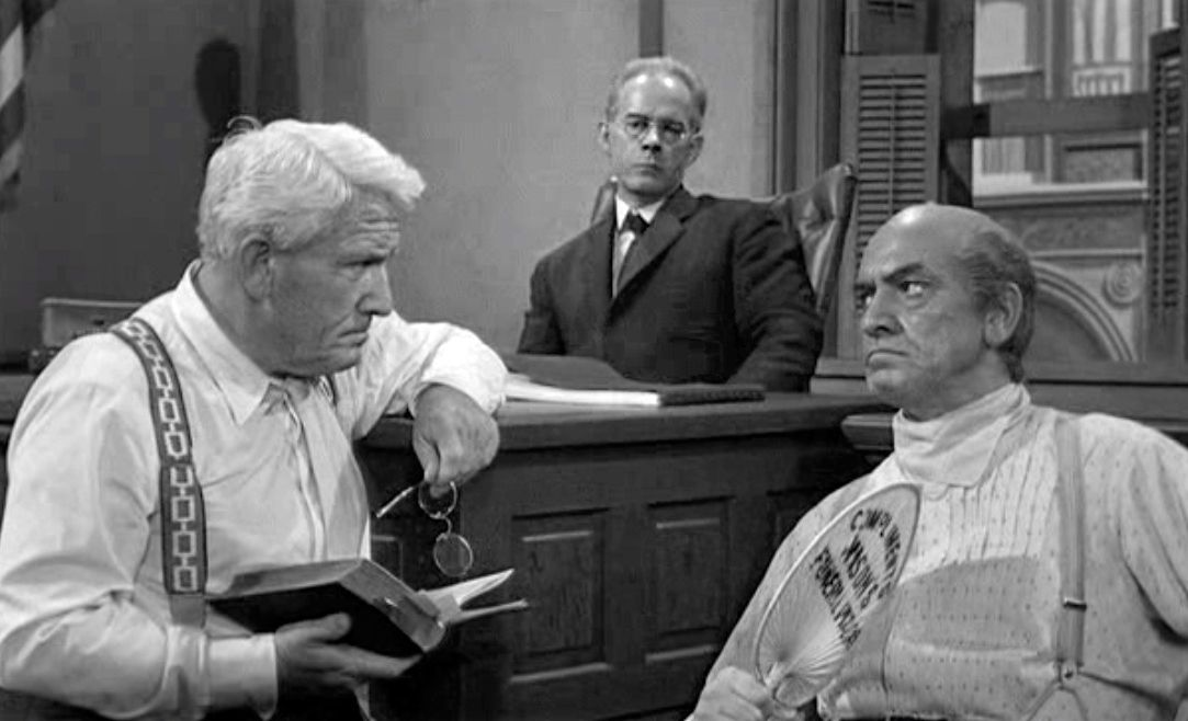 "Spencer Tracy interrogates Fredric March in ""Inherit The Wind"""