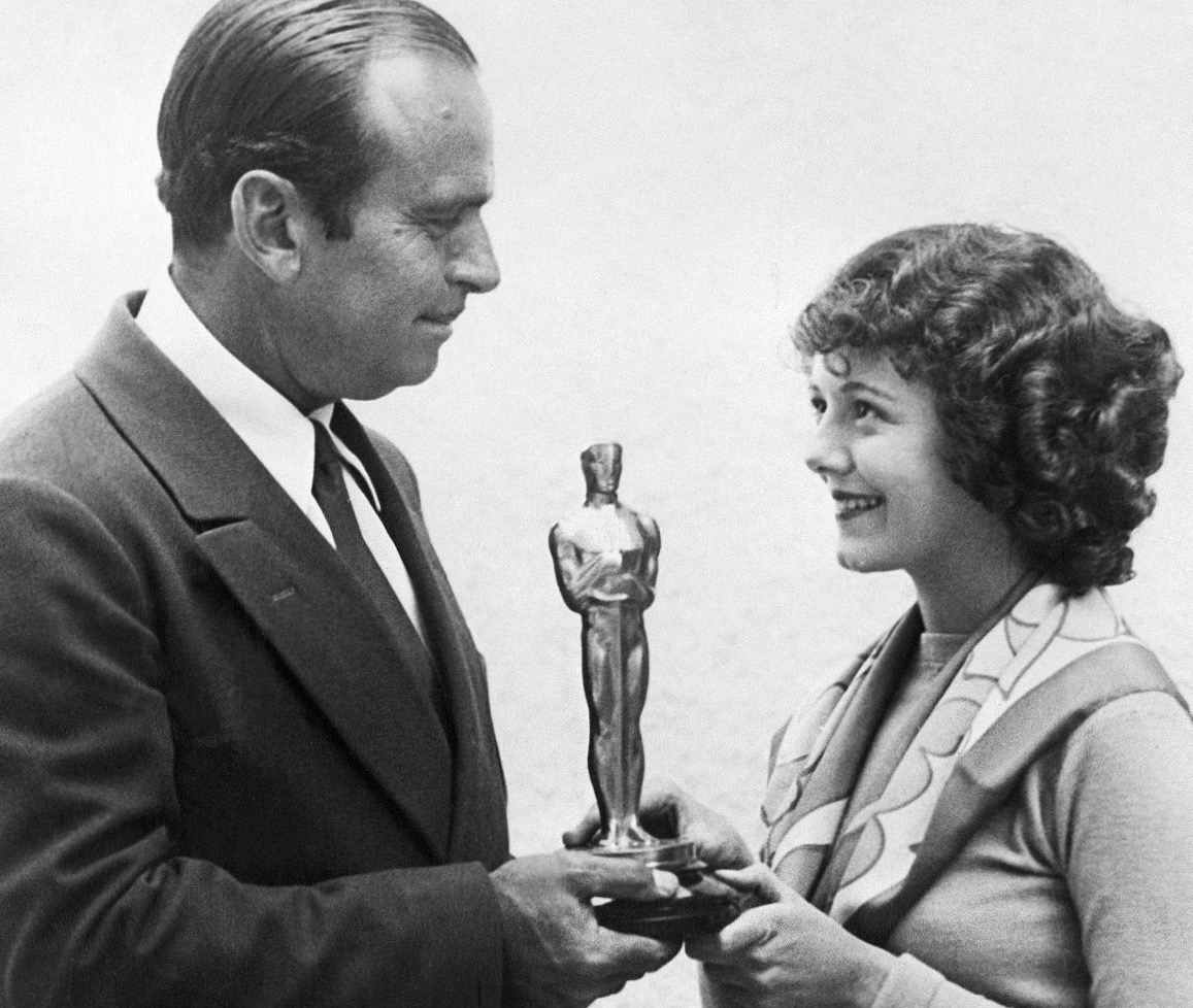 Janet Gaynor, the only woman to win Best Actress for multiple roles, receives her award from Douglas Fairbanks