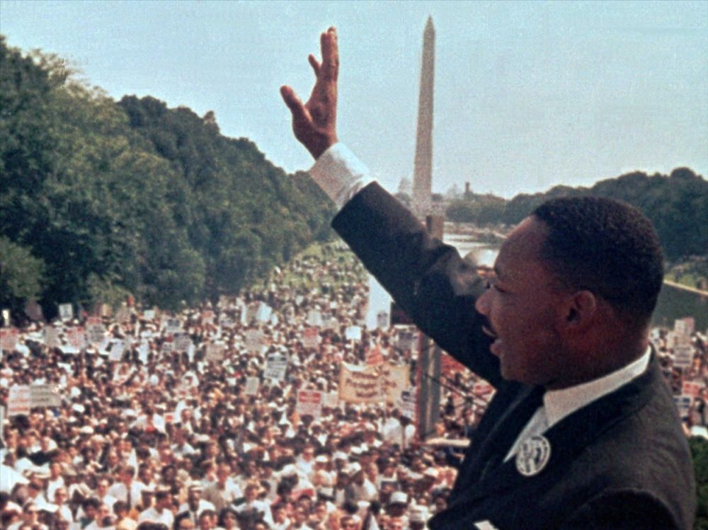Martin Luther King waves to supporters after delivering his 'I have a dream' speech