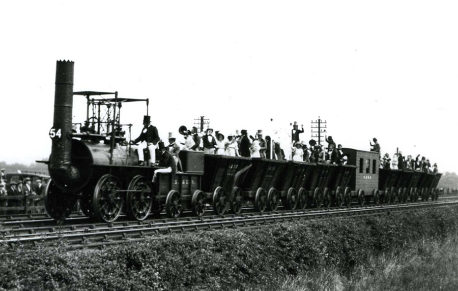 A photograph taken during celebrations to mark the centenary of the 1825 event with Locomotion 1 pulling the world's first rail passengers