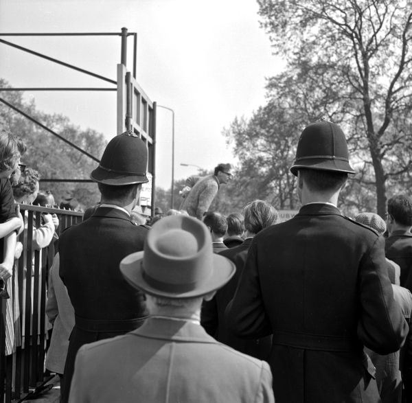 "Watched by London ""Bobbies"", a man makes his point at Speakers' Corner. Photo © Moyra Peralta"
