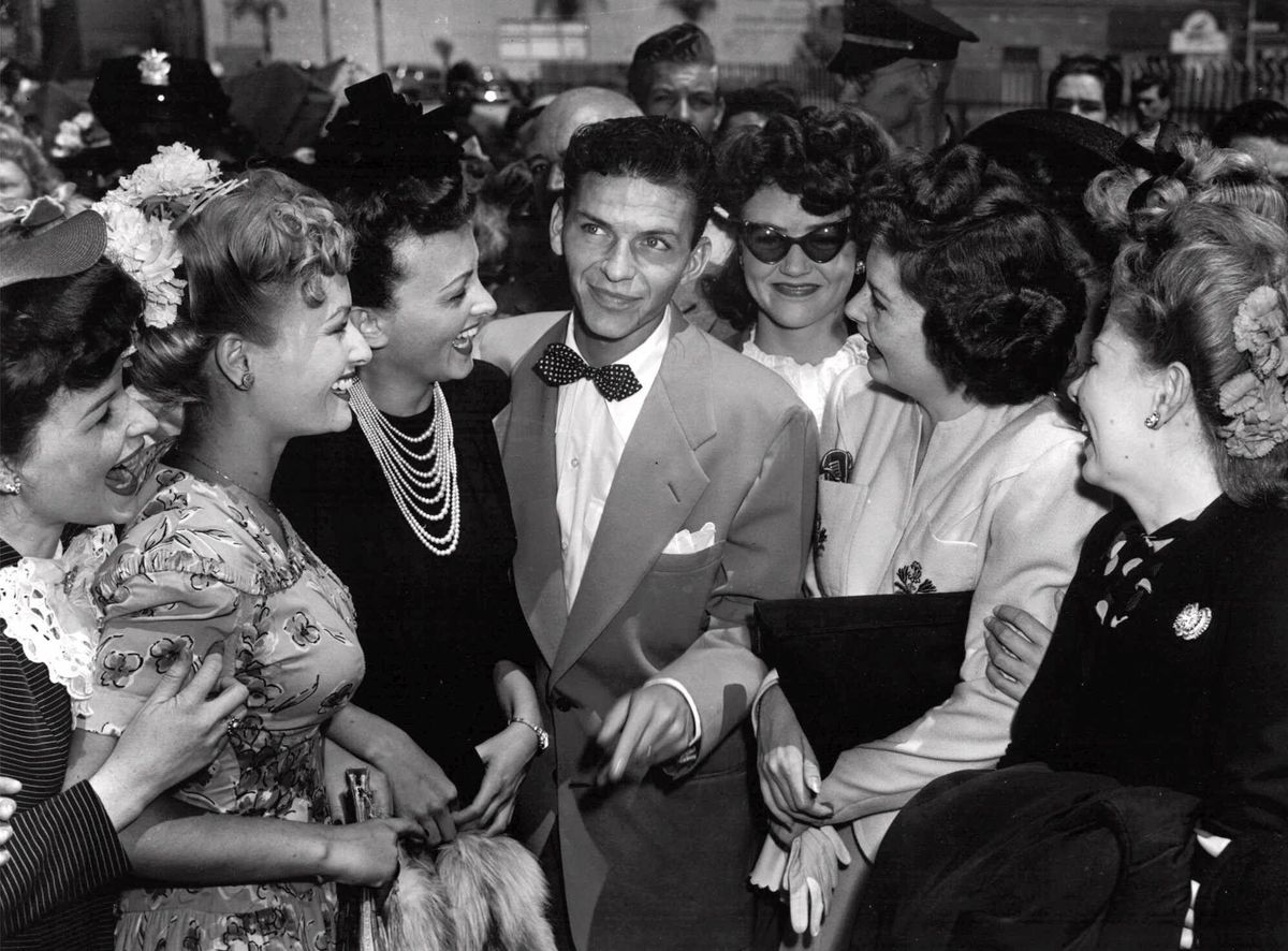 A young Sinatra and adoring fans. Photo:  John T. Burns/AP