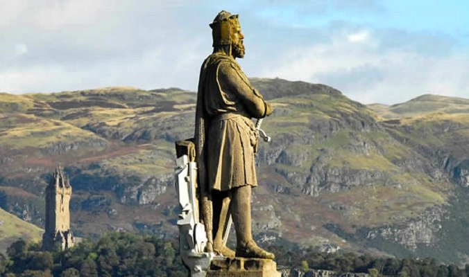 Robert the Bruce stands tall overlooking his beloved hills of Scotland