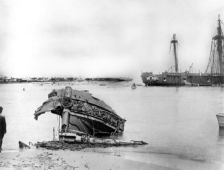 Wrecked ships in Apia Harbour after the storm. The shattered bow of the German gunboat Eber is on the beach in the foreground. Photograph: US Naval Historical Center.