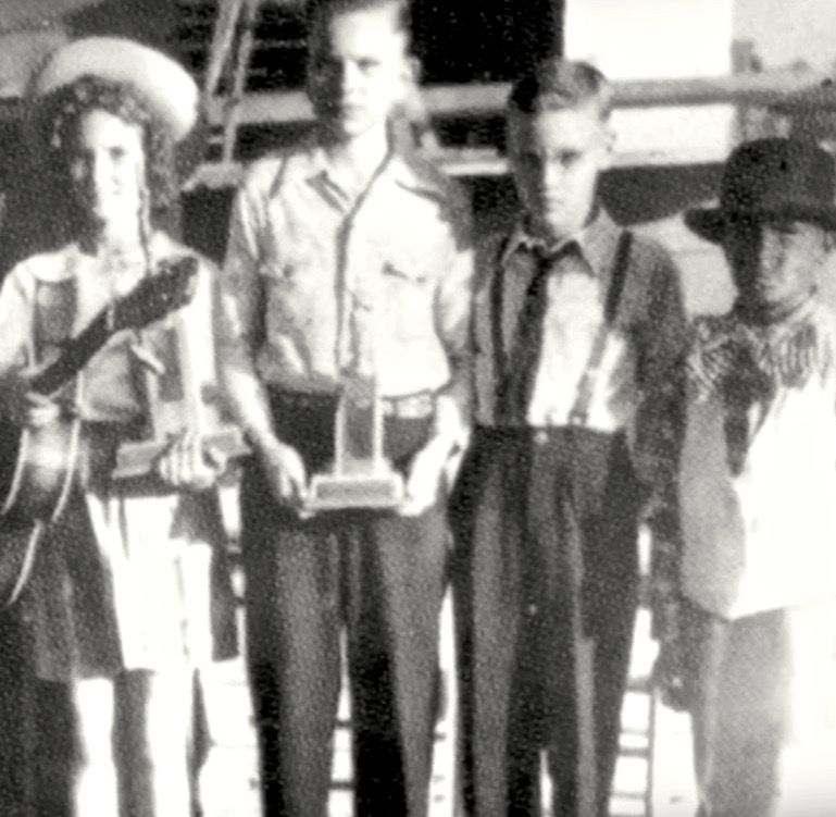 Ten-year-old Elvis, second from right and wearing glasses, with talent show winners