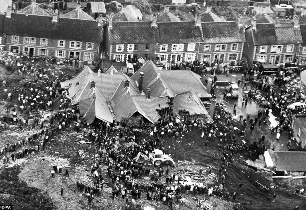 The rooftops of Pantglas Junior school poke out of the sludge and debris that engulfed it as rescuers continue to hunt for survivors