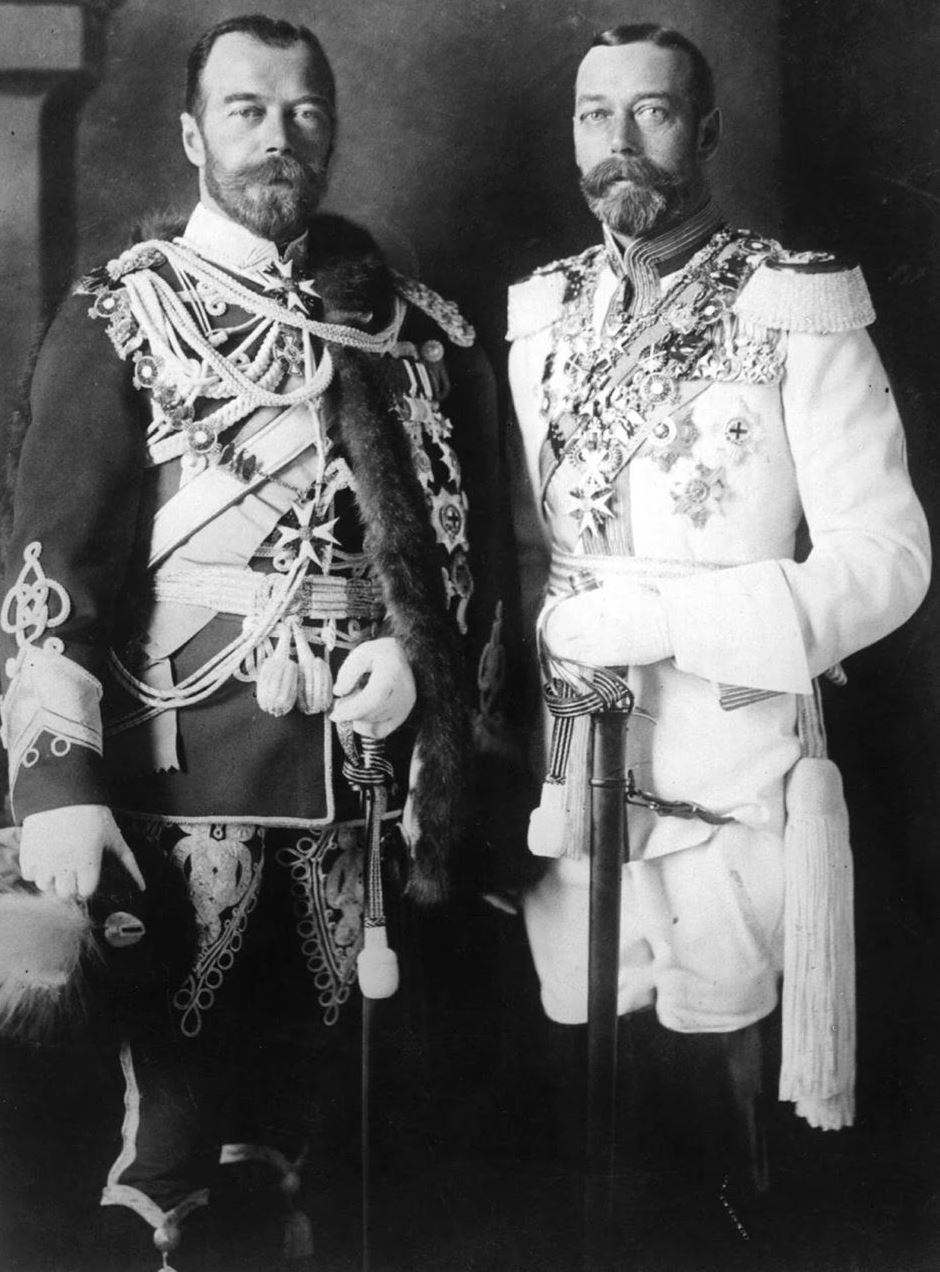 Tsar Nicholas poses with his lookalike cousin King George V (right), both dressed in German military uniform