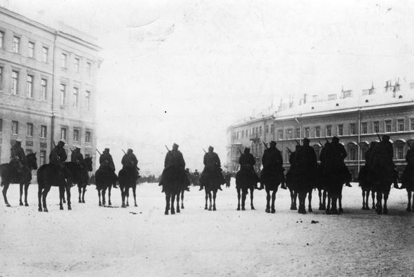 Tsarist troops wait outside the Winter Palace in St. Petersburg