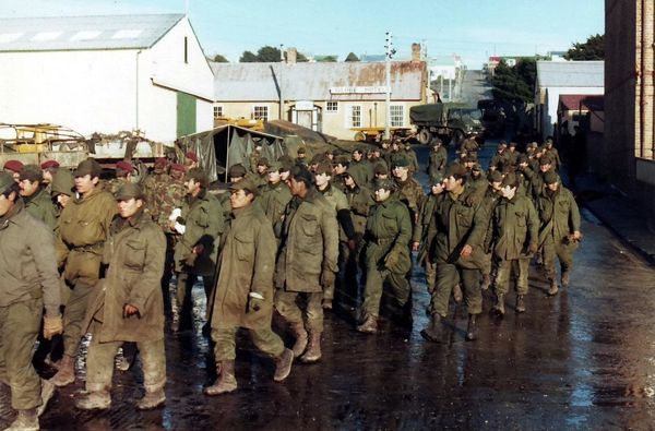 Argentinian prisoners of war are marched in Port Stanley after they surrendered in the Falklands War