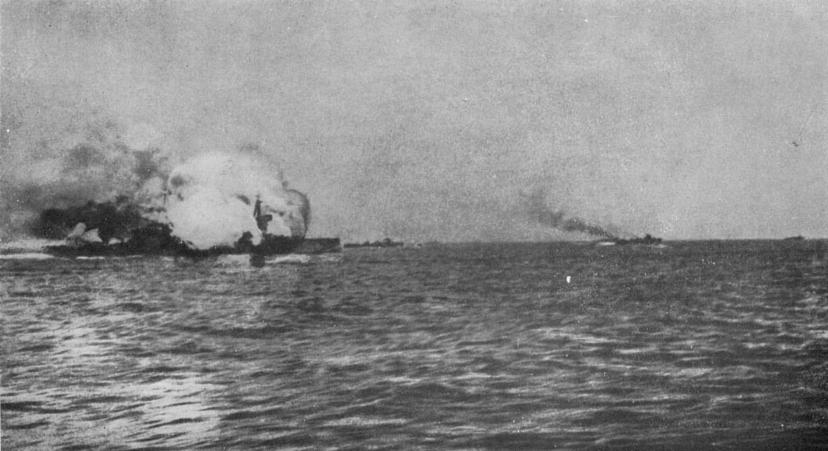 HMS Invincible on fire after being struck by shells from SMS Lützow and SMS Derfflinger