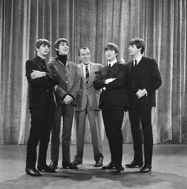 The Beatles with TV host Ed Sullivan during their first appearance on his show in February 1964