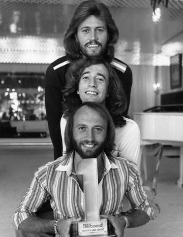 The Bee Gees collect a Billboard #1 Music Award for Saturday Night Fever