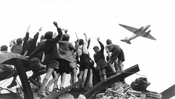 Children in Berlin await US aircraft dropping candy over the city during the Berlin Airlift in 1948