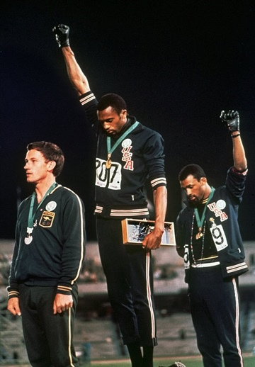 Tommie Smith and John Carlos on the podium at 1968 Olympics