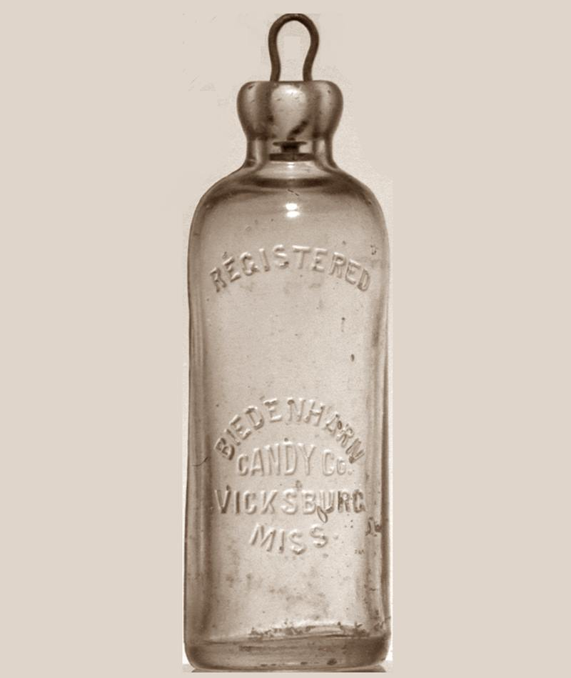 A glass bottle called a Hutchinson used by Joseph A. Biedenharn to bottle Coca-Cola
