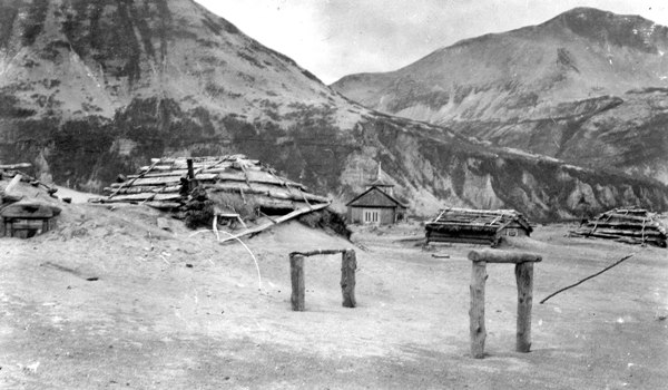 Ash drifts around Katmai village barabaras (sod houses) after the June 1912 eruption of Novarupta