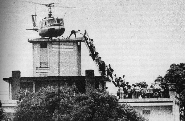 South Vietnamese civilians scramble to board a CIA helicopter during the evacuation of the US embassy in Saigon