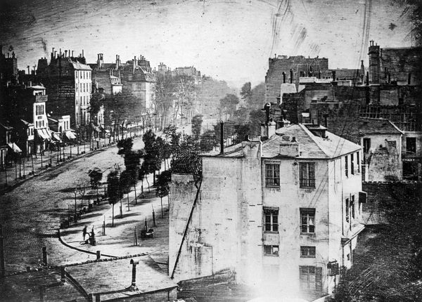 In the bottom left corner a man can be seen having his shoes shined on the Boulevard du Temple in Paris