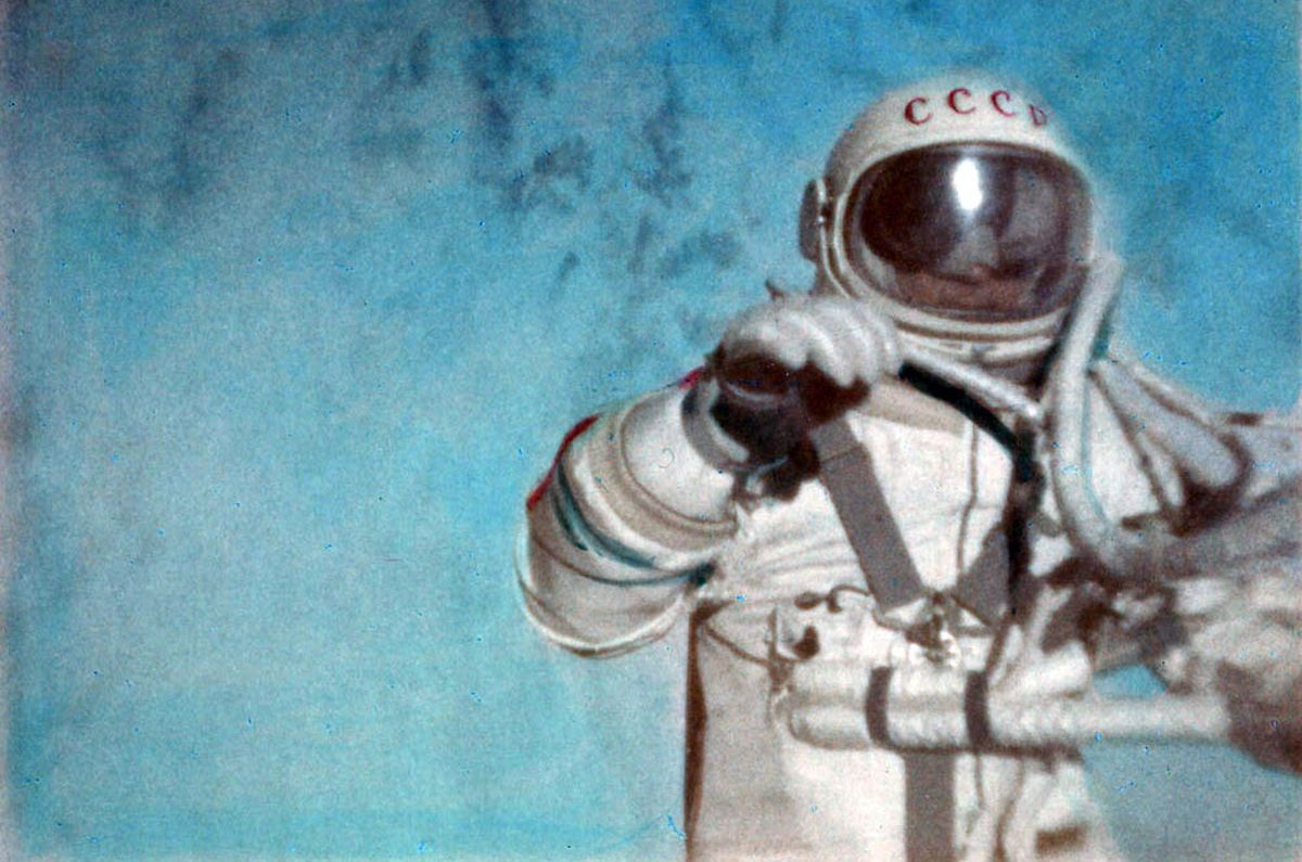 Soviet cosmonaut Alexey Leonov conducts the first spacewalk during the Voshkod 2 mission