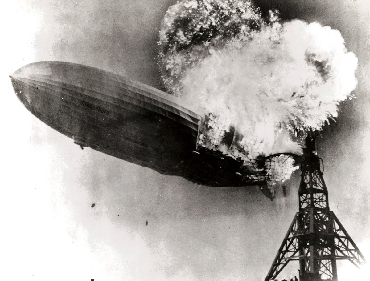 The Zeppelin Hindenburg begins to fall seconds after catching fire