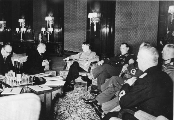 Adolf Hitler meets with Czech President Emil Hácha. After being told of the impending invasion by Germany, Hácha suffered a heart attack at the meeting.