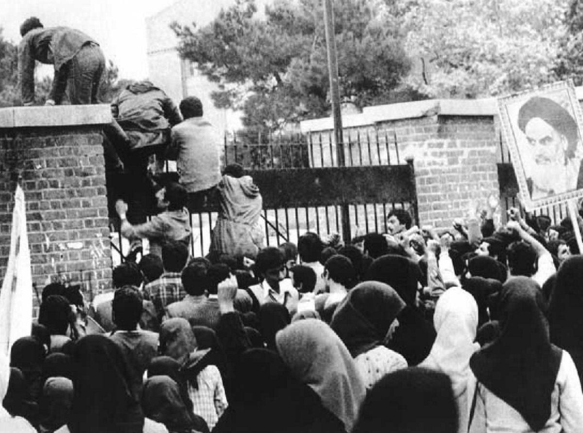 Iranian students storm the walls of the US Embassy in Tehran