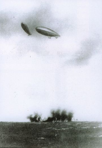 Italian airships bomb Turkish positions. The Italo-Turkish War was the first conflict to feature aerial bombardment.