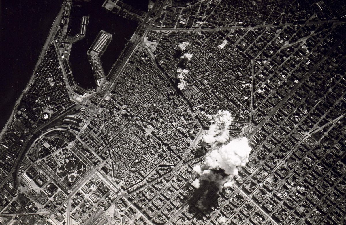 The Italian Air Force conducts a bombing campaign in Barcelona during the Spanish Civil War