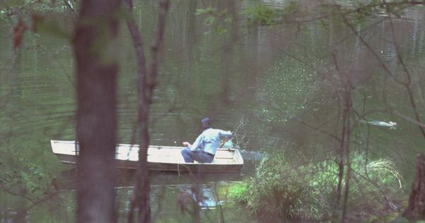 Jimmy Carter shoos away the infamous rabbit as he goes fishing in his hometown in Georgia