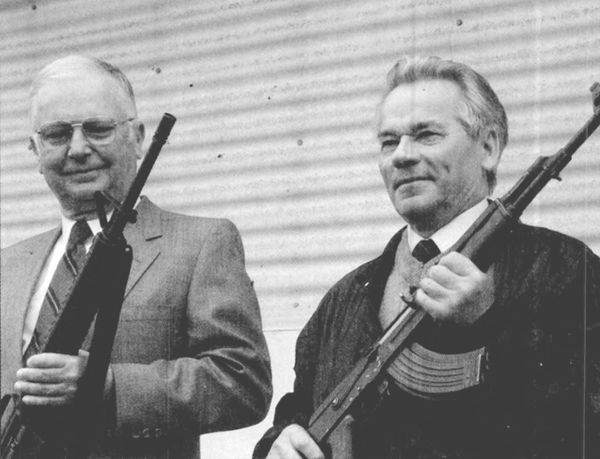 The inventor of the AK-47, Mikhail Kalashnikov (right), meets the inventor of the M-16, Eugene Stoner (left)