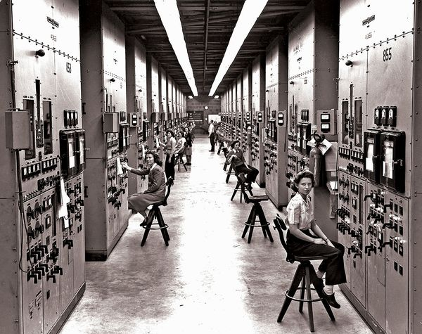 'Calutron Girls' monitoring a mass spectrometer during the Manhattan Project. Gladys Owens, in the foreground, did not know what she was involved with until seeing this picture on a tour fifty years later.