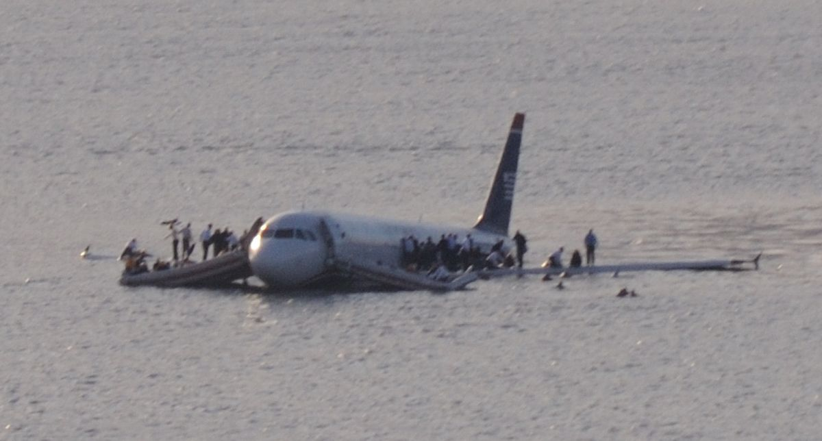 Passengers wait to be rescued on the wings of US Airways Flight 1549 in the Hudson River