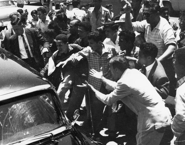 The car of US Vice President Richard Nixon is attacked by a mob during a visit to Venezuela in 1958