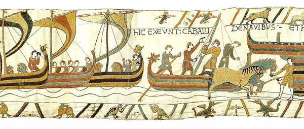 William the Conquerer and his army land at Pevensey as depicted in the Bayeux Tapestry