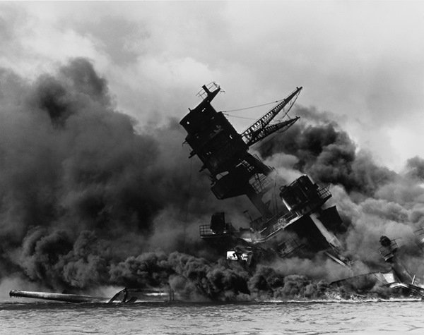 USS Arizona ablaze and sinking after the attack on Pearl Harbor