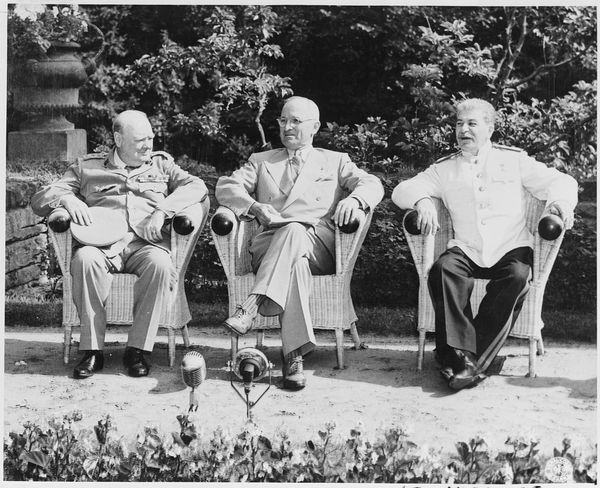 Winston Churchill, Harry S. Truman and Josef Stalin in the garden of Cecilienhof Palace before meeting for the Potsdam Conference