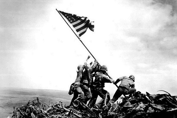 United States Marines raise the U.S. flag atop Mount Suribachi, during the Battle of Iwo Jima
