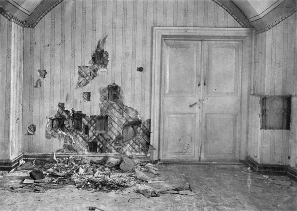 The basement room in Ipatiev House where the Romanov royal family and their staff were executed. The holes in the walls are from investigators searching for bullets.
