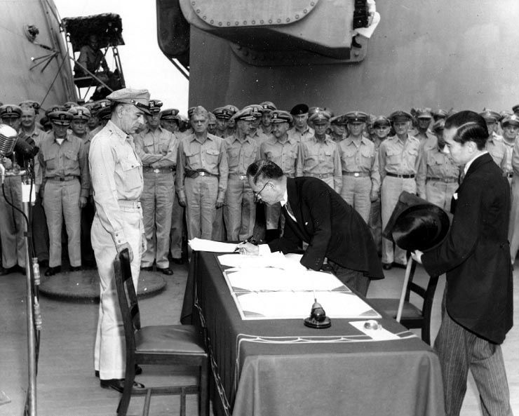 Japanese Foreign Minister Mamoru Shigemitsu signs the Instrument of Surrender to formally end World War II